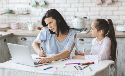 Little girl trying to get mother's attention while she working