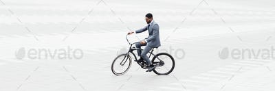Businessman riding bicycle to work in city center