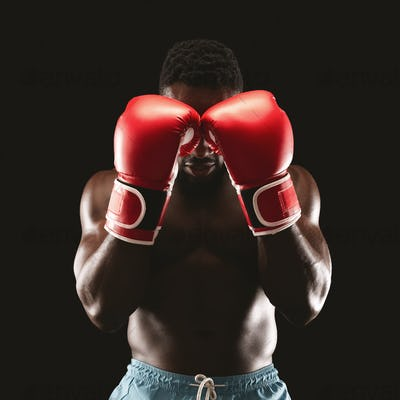 Portrait of professional boxer showing defence pose