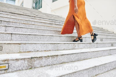 Woman moving up the stairs