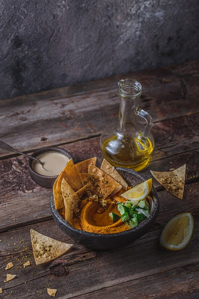 Lentil hummus with olive oil and flat bread, copy space