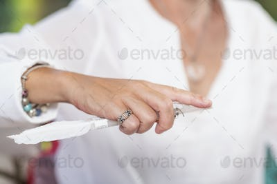 Guardian Angel Virtue, Hand of a Spiritual Healer Holding a Crystal with White Feather