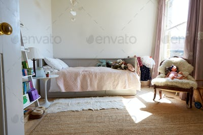 Empty Interior Of Young Girls Bedroom With Desk And Storage