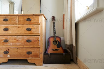 Room Interior With Chest Of Drawers And Acoustic Guitar In Contemporary Bedroom