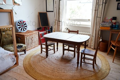 Empty Interior Of Young Boys Bedroom With Table And Storage