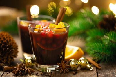 Christmas, Xmas, New Year or Noel mulled red wine with spices, cranberry and oranges