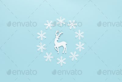 Christmas, New Year or Noel holiday festive winter greeting card, deer and snowflakes