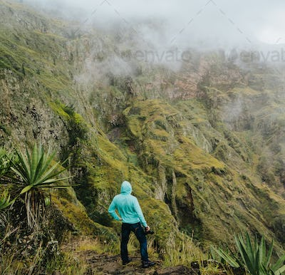 Taking photo on the edge of of gorgeous canyon valley on the path from Xo-Xo Valley. Santo Antao