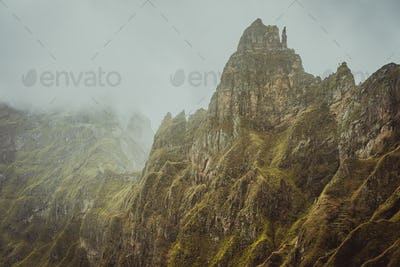 Harsh rugged mountain peaks between Xo-xo and Paul Valley overgrown with verdant grass. Santo Antao
