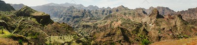 Gorgeous panorama view of huge barren mountain peaks, cliff and canyons of dry arid desert landscape