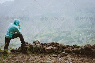 Traveler on the edge in of rural landscape with mountains, on the way of the Paul Valley. Santo