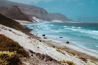 Stunning view over barren rugged volcanic cliffs and sand dunes. Vast plain of the coastline. Baia