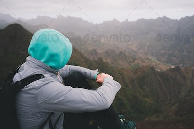 Traveler enjoying magnificent remote moment above huge mountain ranges on Santo Antao island, Cape