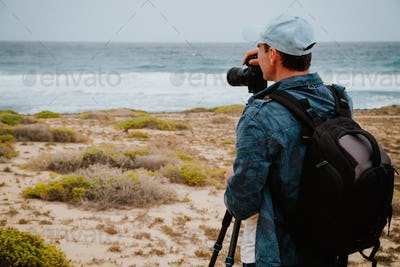 Photographer takes a picture of ocean breakers and waves on Sao Vicente Island Cape Verde