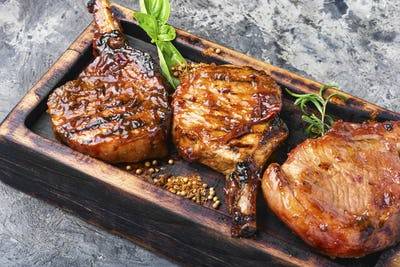 Grilled meat in plum sauce