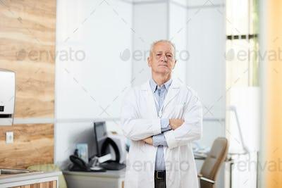 Portrait of Senior Doctor in Clinic