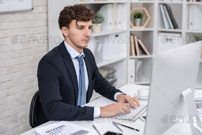 Businessman Using PC in Office