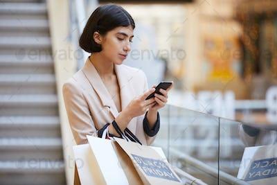 Elegant Woman Leaving Boutique