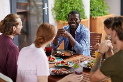 Diverse Group of Friends Enjoying Lunch Together