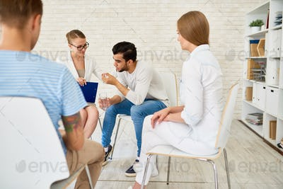 Young Man in Group Therapy Session