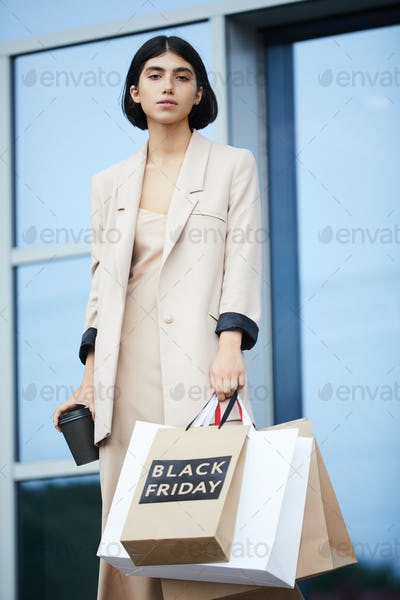 Elegant Woman Shopping on Black Friday