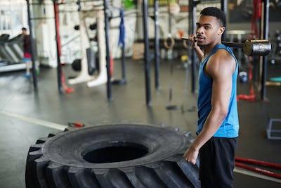 Handsome African Sportsman posing in Gym