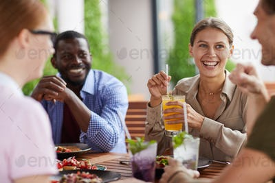 Cheerful Friends Enjoying Lunch Together