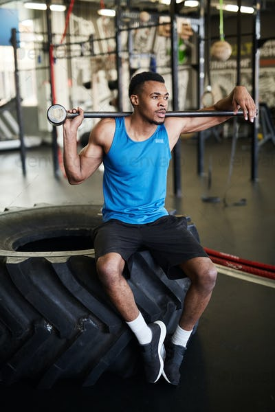 Muscular African-American Man with Cross Training Equipment