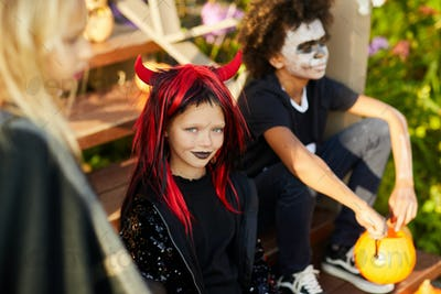 Little Girl with Friends on Halloween