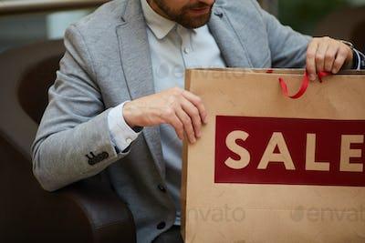 Unrecognizable Man Holding Shopping Bag