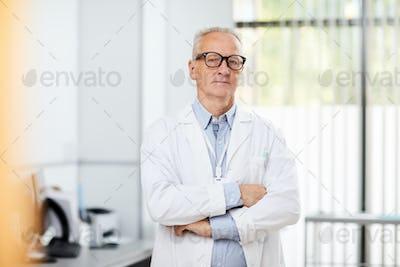 Senior Doctor Posing in Clinic
