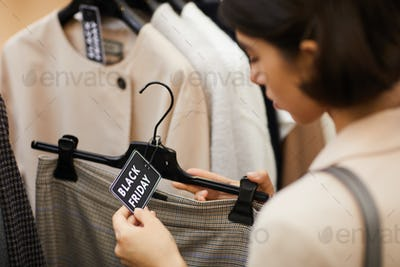 Woman Buying Clothes on Sale