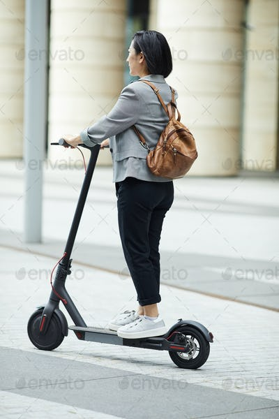 Asian Woman Riding Electric Scooter
