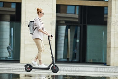 Young Woman Riding Electric Scooter Background