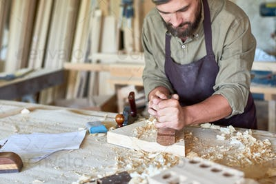 Carpenter Working in Traditional Woodworking Shop