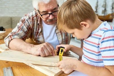 Granddad and Little Boy Working Together