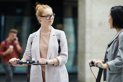 Young Women Travelling in City
