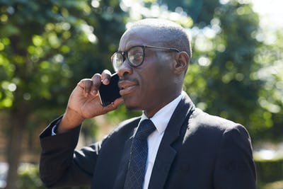 African-American Businessman Speaking by Smartphone