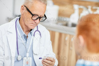 Doctor Checking Childs Fever