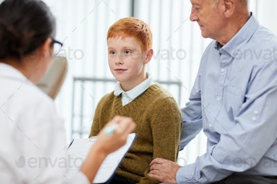 Dad and Son Visiting Doctor