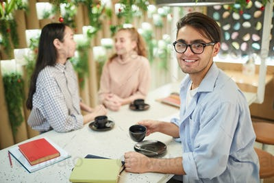 Smiling Mixed-race Student in Cafe