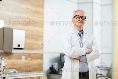 Confident Senior Doctor Looking at Camera