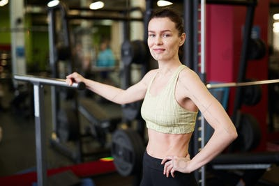 Female Fitness Coach Posing in Gym