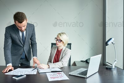 Successful Business Partners Working in Office
