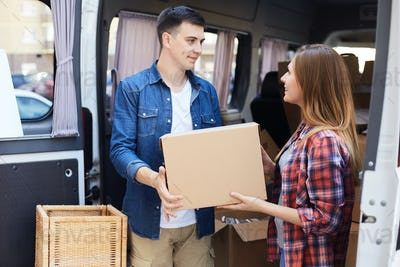 Man and Woman Unloading Moving Van