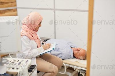 Arab Nurse Filling In Patients Form