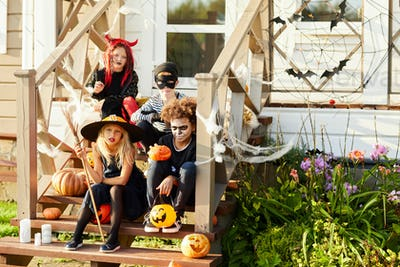 Children in Costumes Posing on Halloween