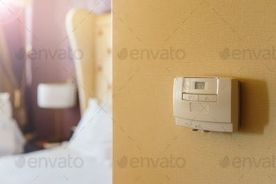 Wall display shows air temperature inside the room.