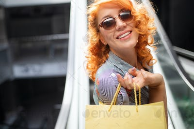 Beautiful shopping happy woman holding shopping bags