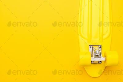 Skateboard On Yellow Background
